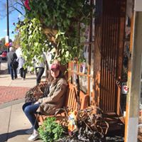Woman Sitting Outside of Main Streets Market & Cafe